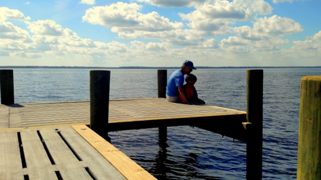 Sitting on the dock with a Neuse River view