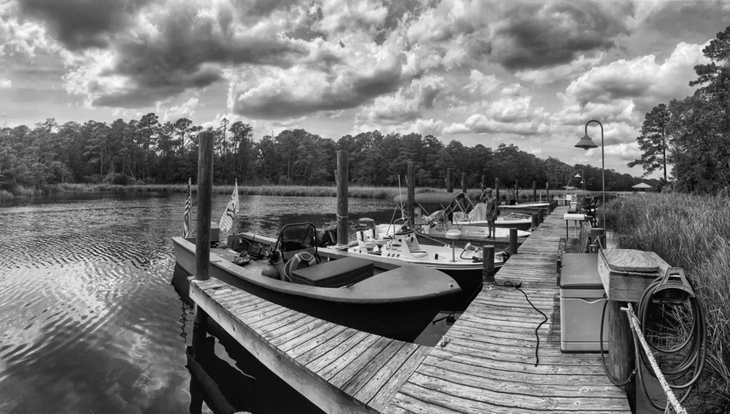 black and white photo of community docks