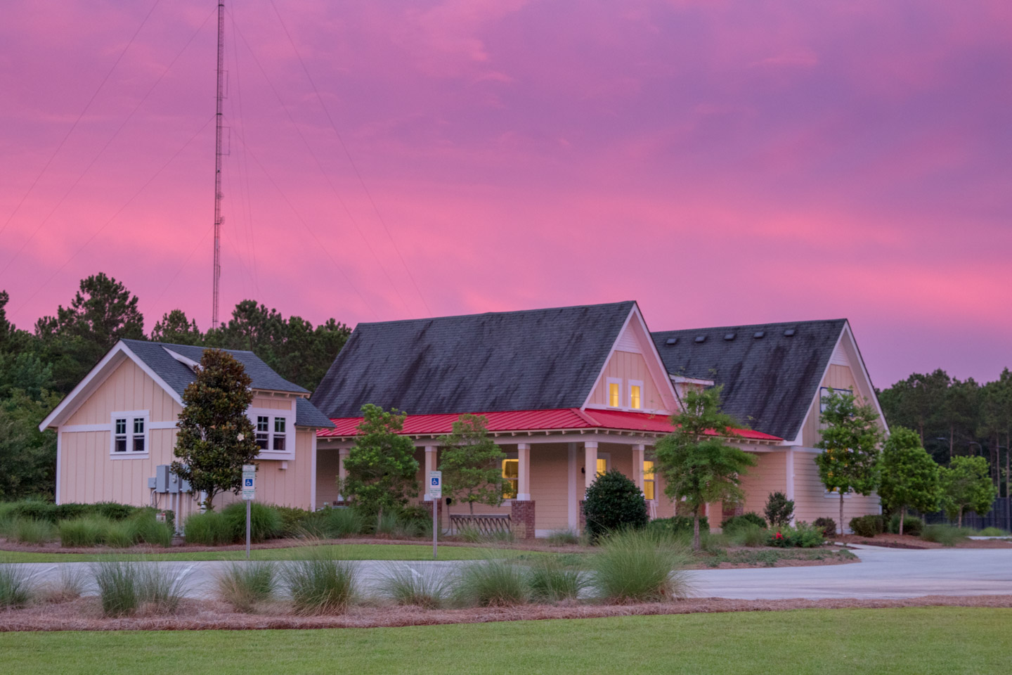 The Arlington Place Clubhouse at sunset.