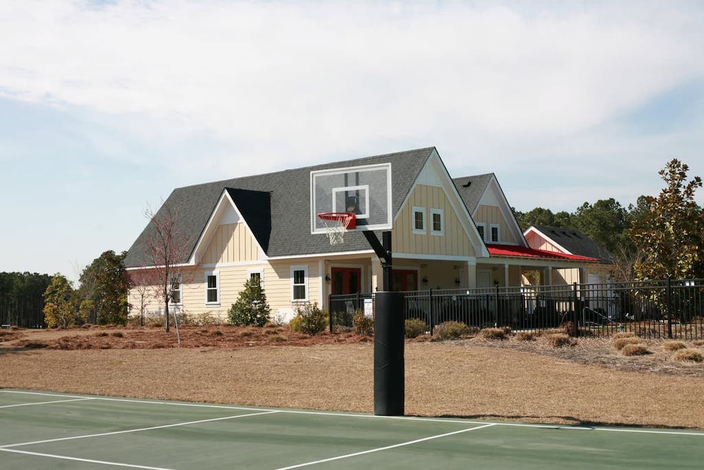 The Arlington Place basketball courts and clubhouse.