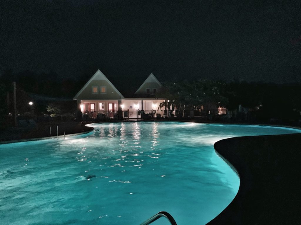 the clubhouse and pool at night
