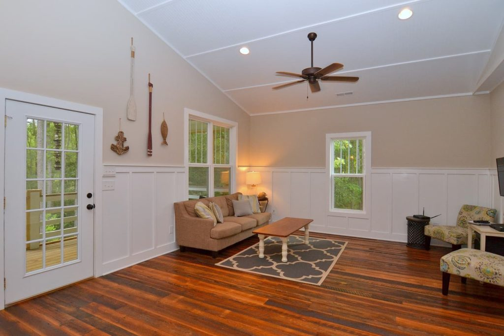 The 1,200 sq ft 3 bed 2 bath 35 N. Cottage has 420 sq ft of open and covered porch space and is next door to the Outfitters Center.