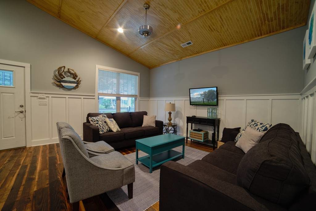 The 3 bed 2 bath Brackish Cottage at Arlington Place has an open floor all on one level and two 30' porches.