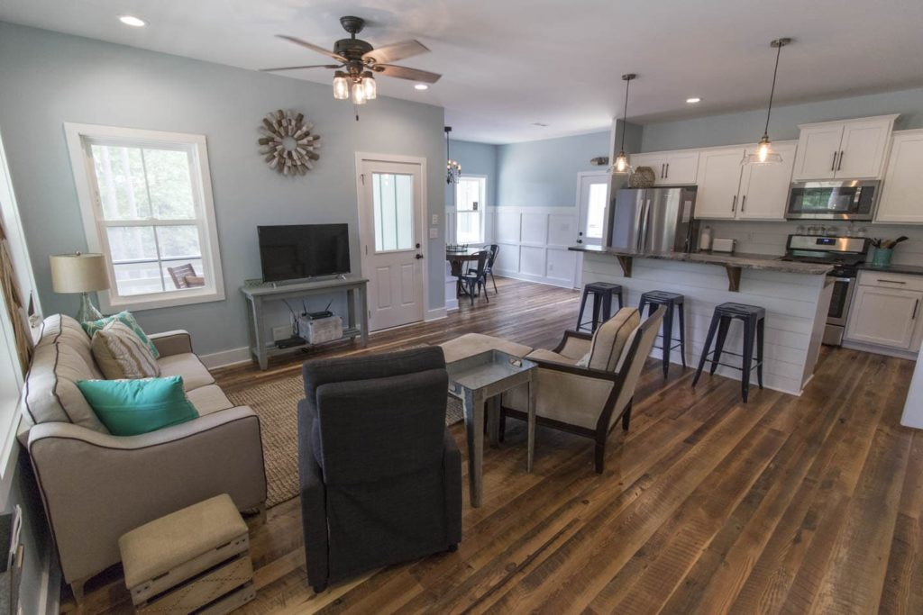 The 2 bed 1.5 bath Creekside Cottage at Arlington Place has two porches a deck and is full of thoughtful details to make your stay comfortable.