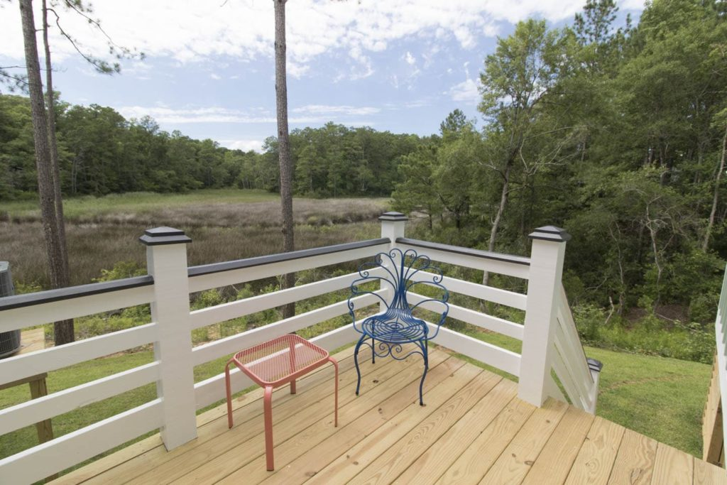 The 2 bed 1.5 bath Sugar Shack at Arlington Place has two porches and blends rustic charm with modern amenities.