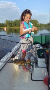 Evie crabbing on the Neuse River.
