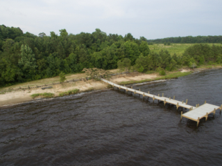 aerial view of river beach and dock on neuse river