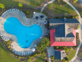 aerial, overhead view of the clubhouse and pool