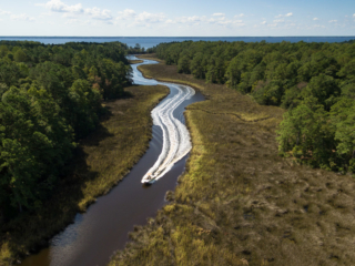 Aerial view of a boat speeding down Mill Creek