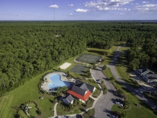 aerial view of the clubhouse, pool, and sports courts