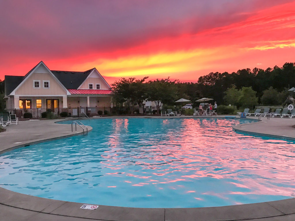 The pool and clubhouse at sunset