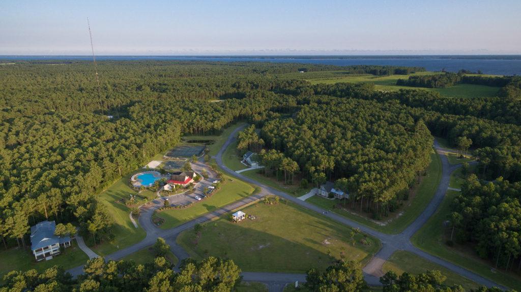 aerial view of pool, amenities, and neighborhood