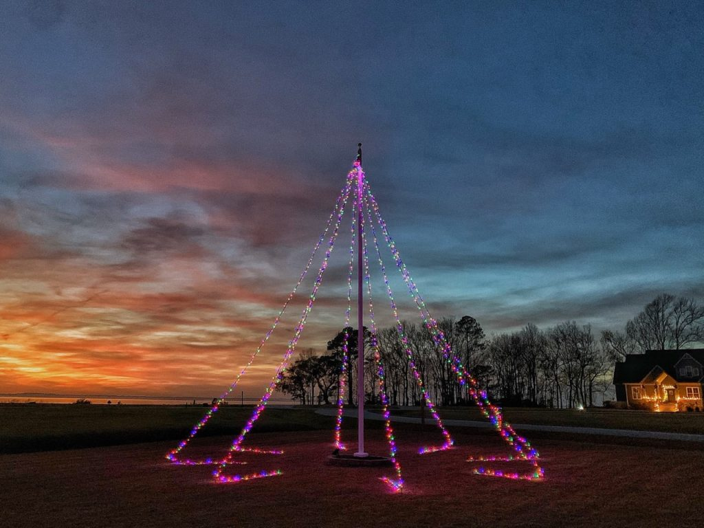 Christmas light teepee at night