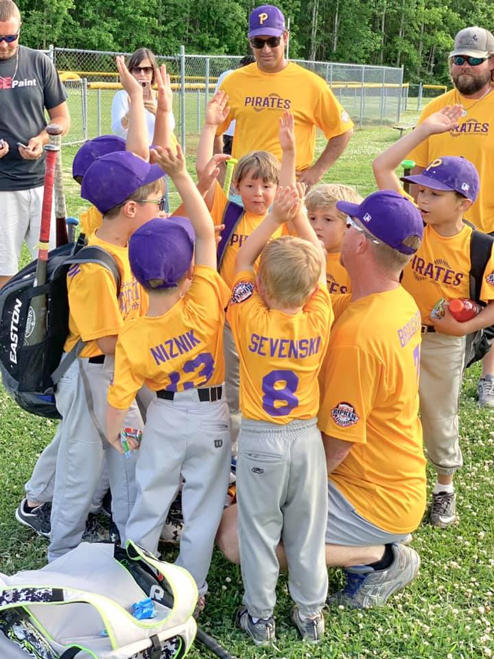 a T-ball team huddles up before a game