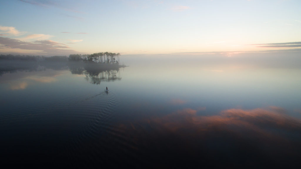 Paddling out into the Neuse River at sunrise on a perfectly calm morning.