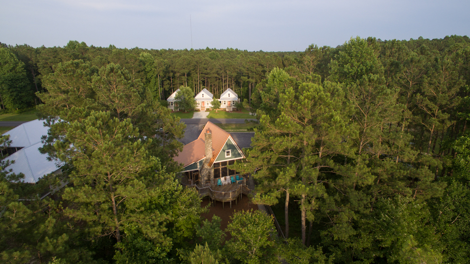 aerial view of the outfitters center with three cottages in the background