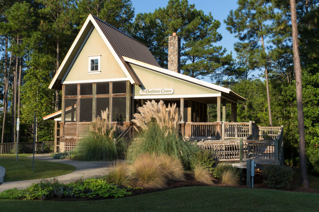 the outfitters center, wraparound porch, and landscaping