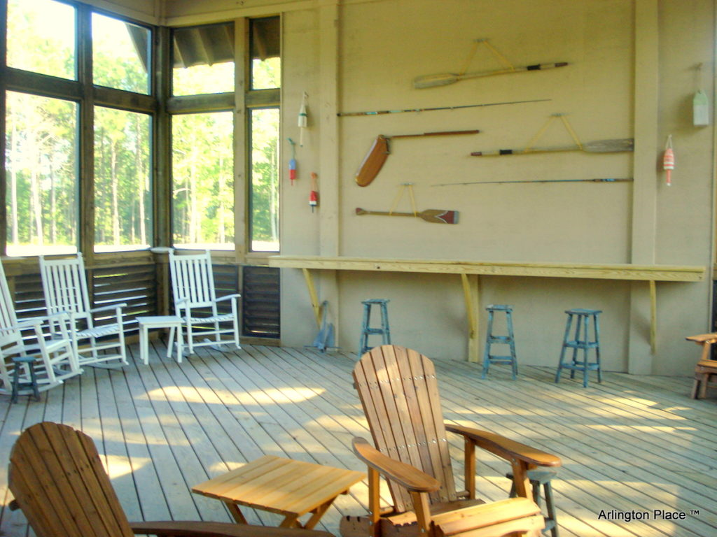 The interior of the outfitters center with rocking chairs and a bar