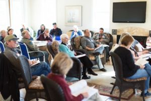Arlington Place residents gather at the clubhouse for a neighborhood meeting.