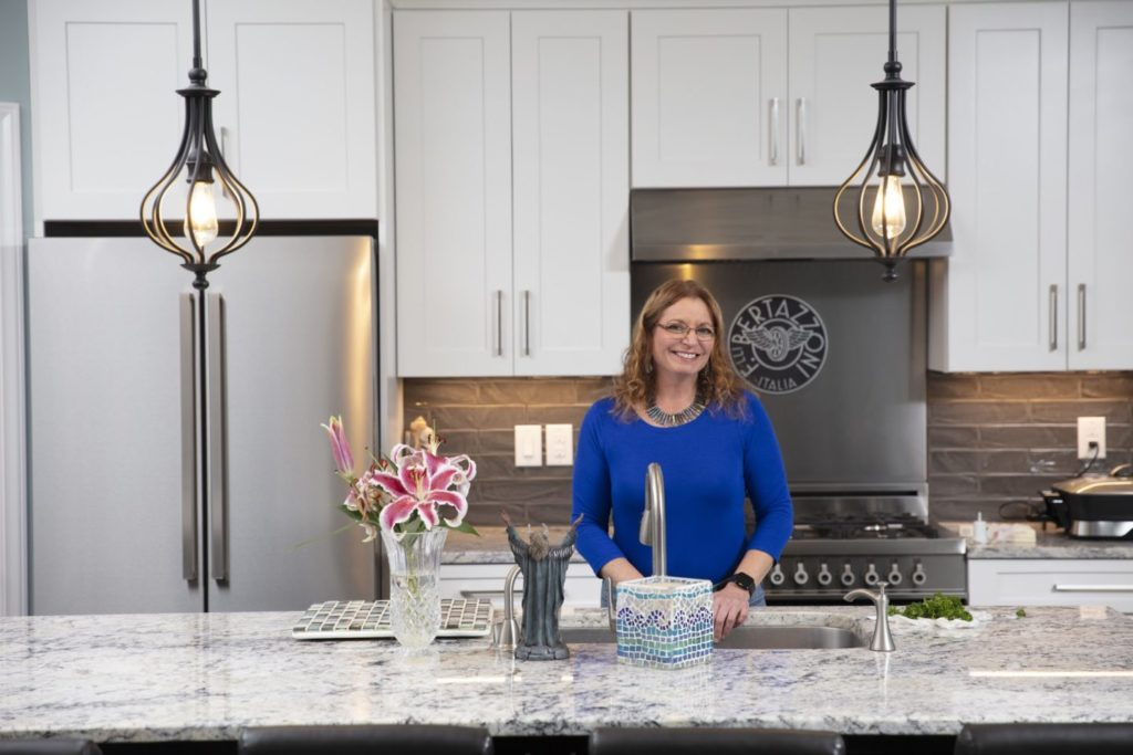 Terri MacMahon in her beautiful custom kitchen by Stroud Custom Homes.