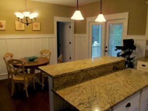Granite counter tops and dining area inside the Pamlico Cottage.