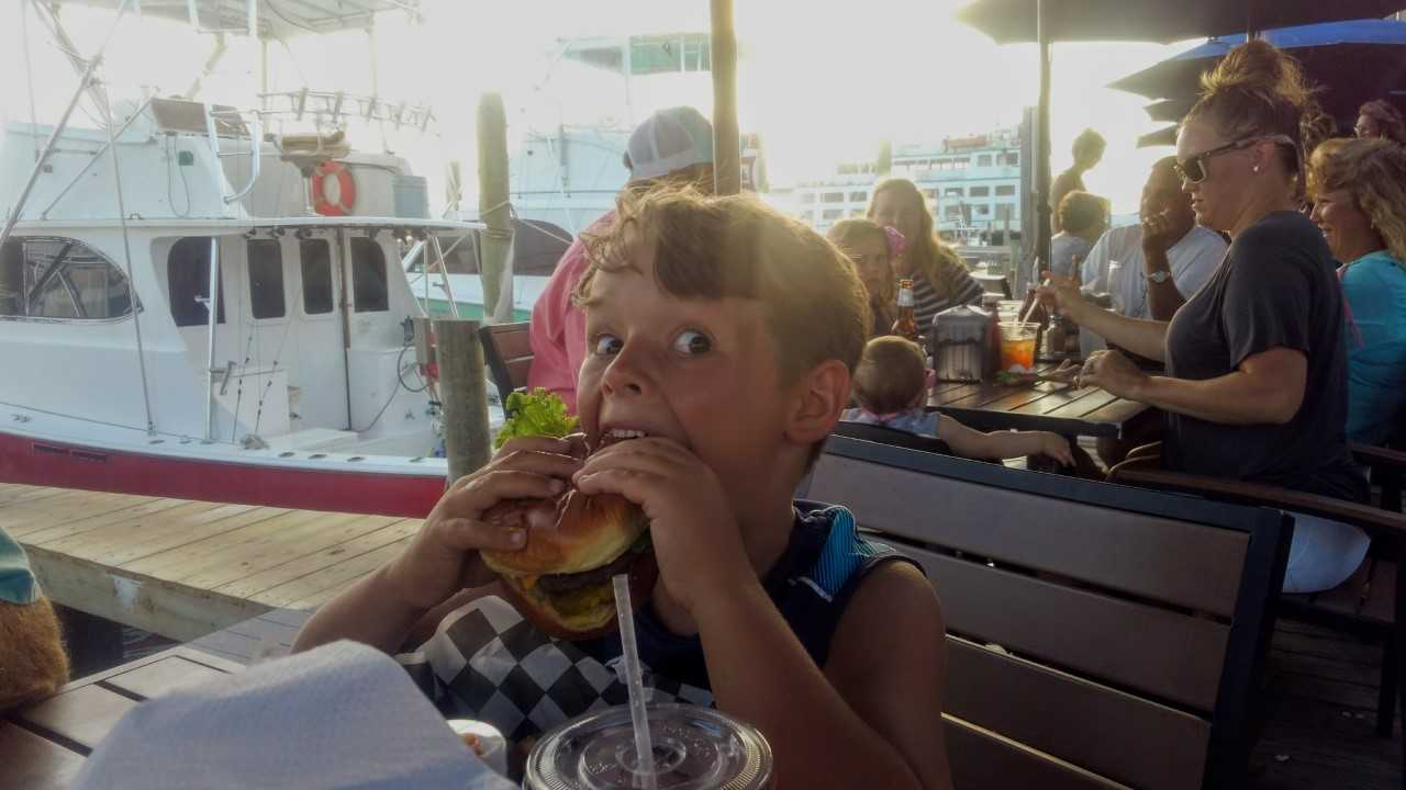 Keegan eating a hamburger in Ocracoke.