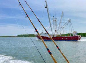 Fishing poles and shrimp trawler.