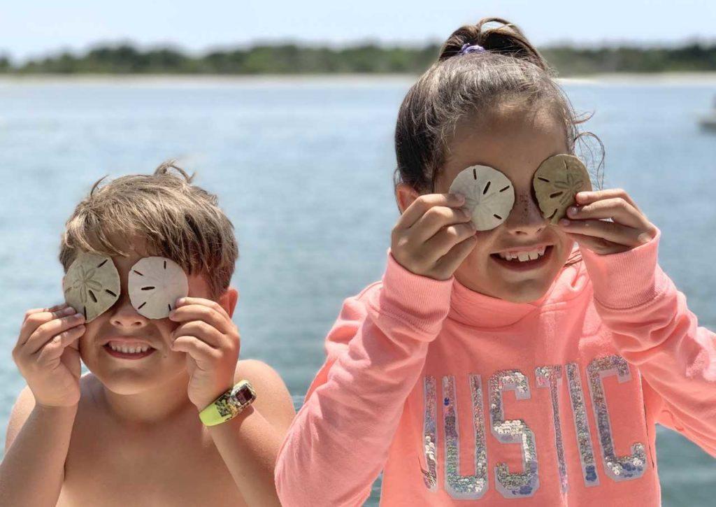 Kids collecting sand dollars on Shackelford Banks.