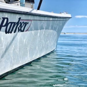 Parker boat in crystal clear water.