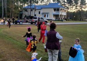 Kids trick or treating in the neighborhood.