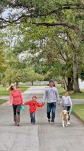 Family walking down the tree lined streets in Oriental, NC.