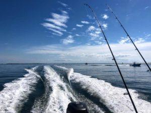 boat wake, Neuse River, fishing poles