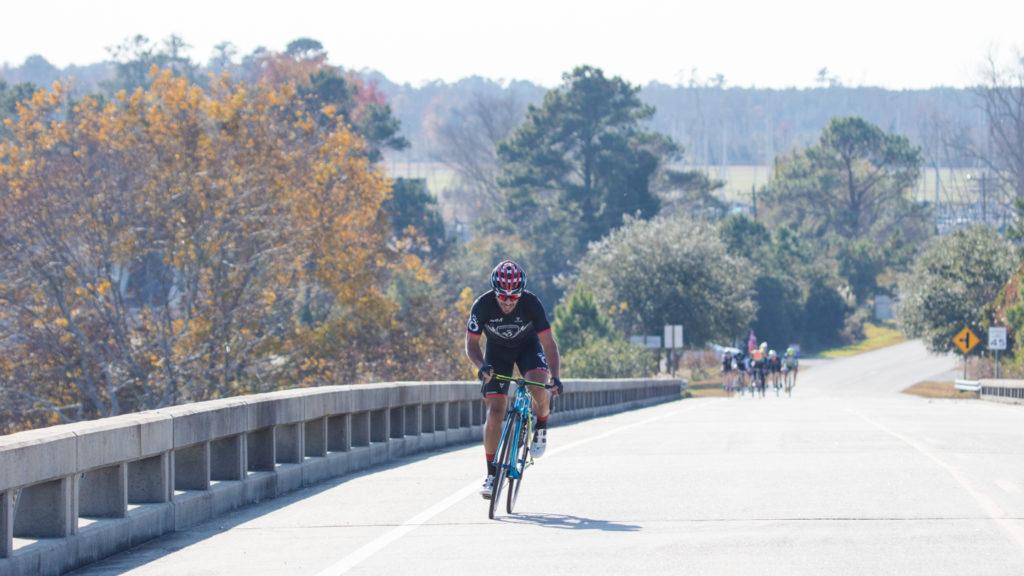 Bike rider heading up the Oriental bridge.