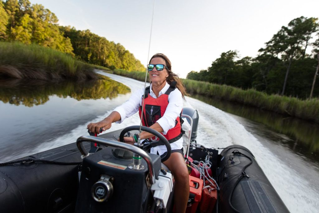 Driving a power boat up Mill Creek. Photography by Will Conkwright.