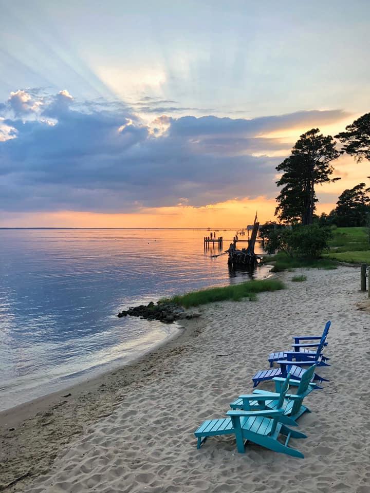riverfront beach at sunset