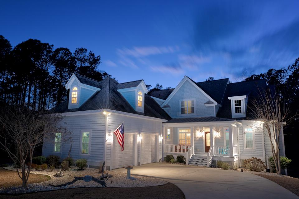 Twilight photograph of coastal style home.
