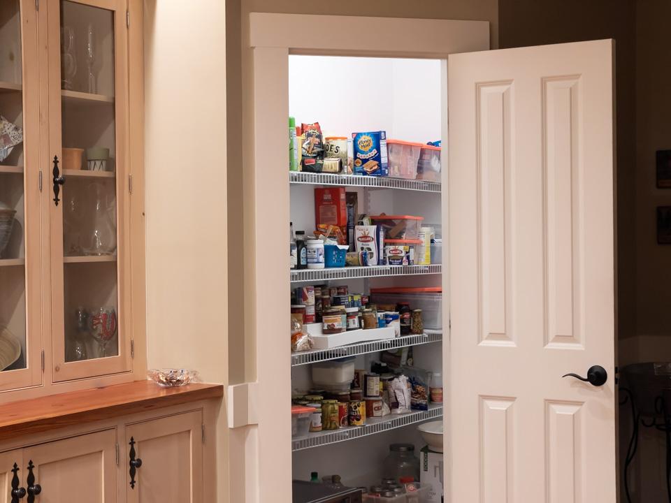 Walk-in pantry inside a coastal estate home at Arlington Place.