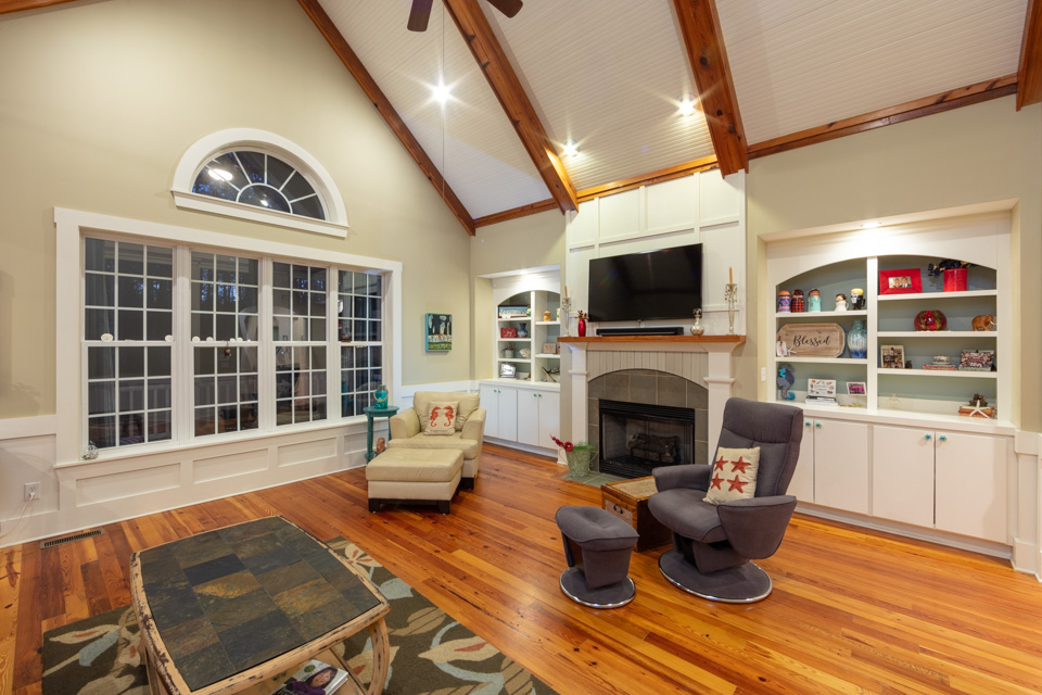 Open air living room with vaulted beadboard ceilings.