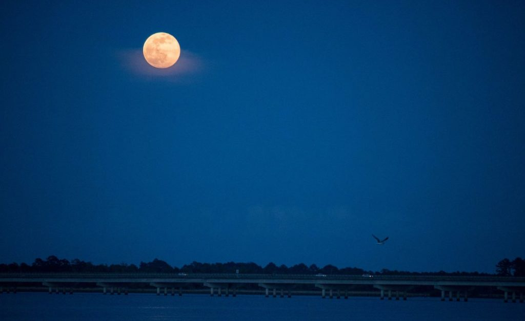 Full moon over the Neuse River as seen from Persimmons Restaurant in New Bern, NC.