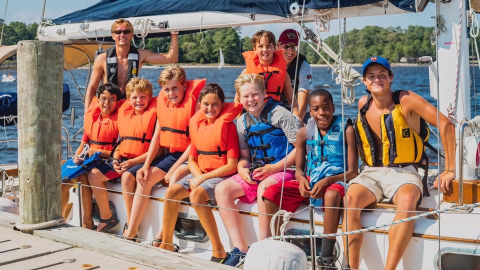 camp kids on a sailboat